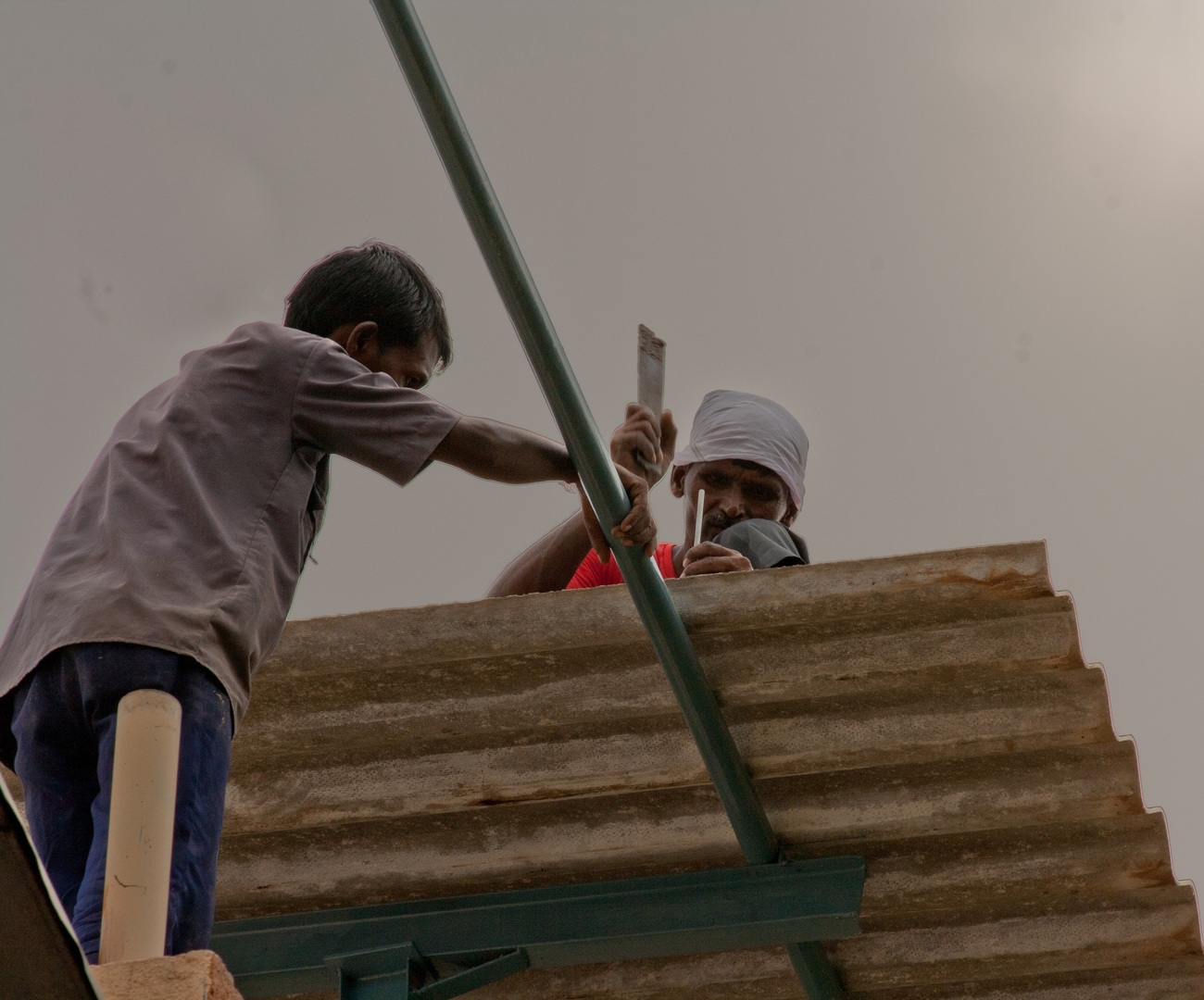 2 people working at a construction site