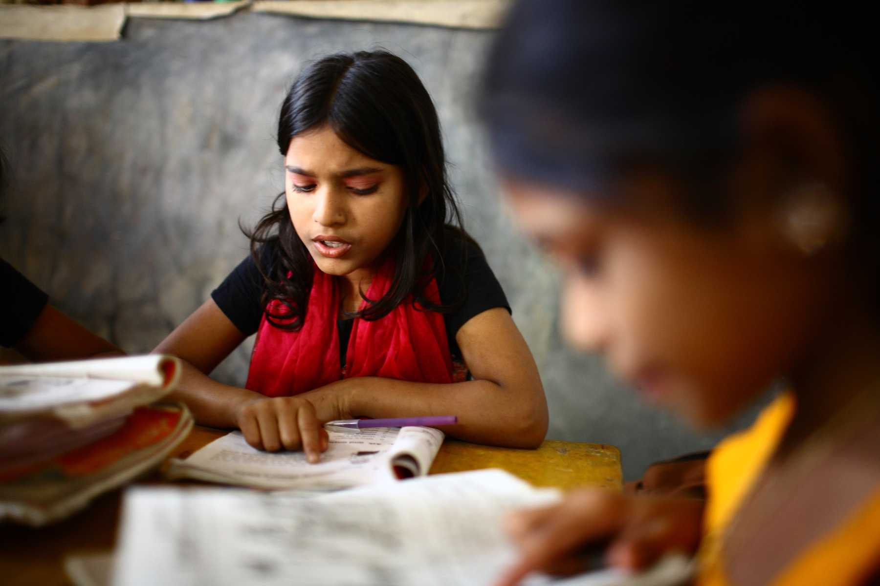 Two children studying at Unique Child learning Centres in Dhaka