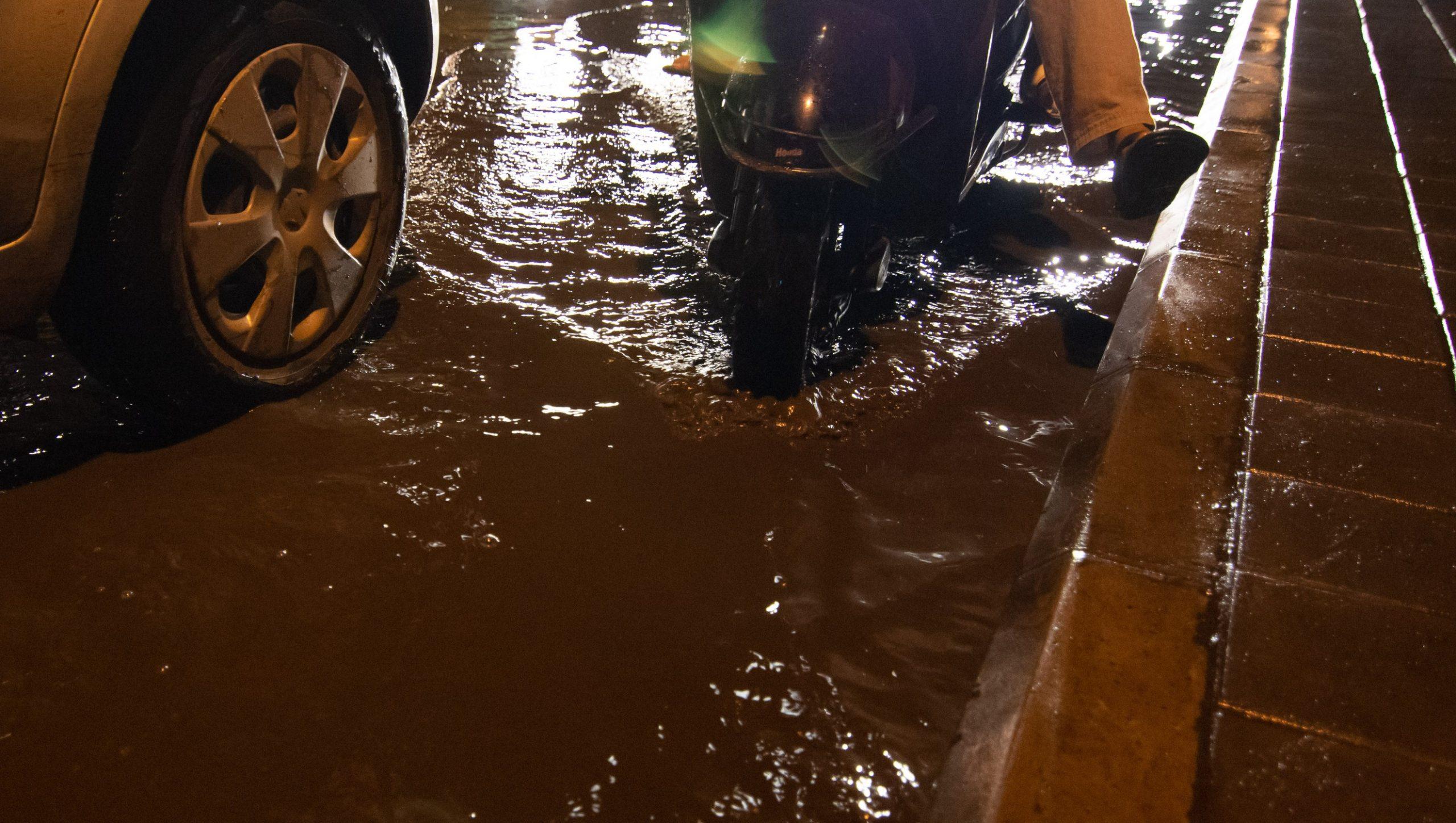 Rainwater clogged city traffic_sanitation workers_epw