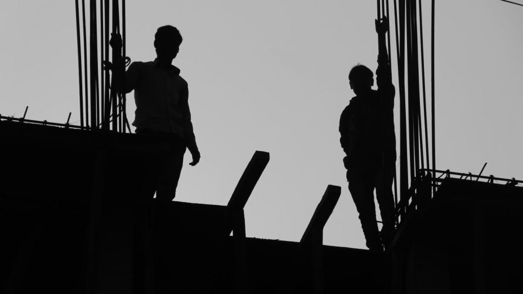 Migrant labourers at a construction site in Lucknow