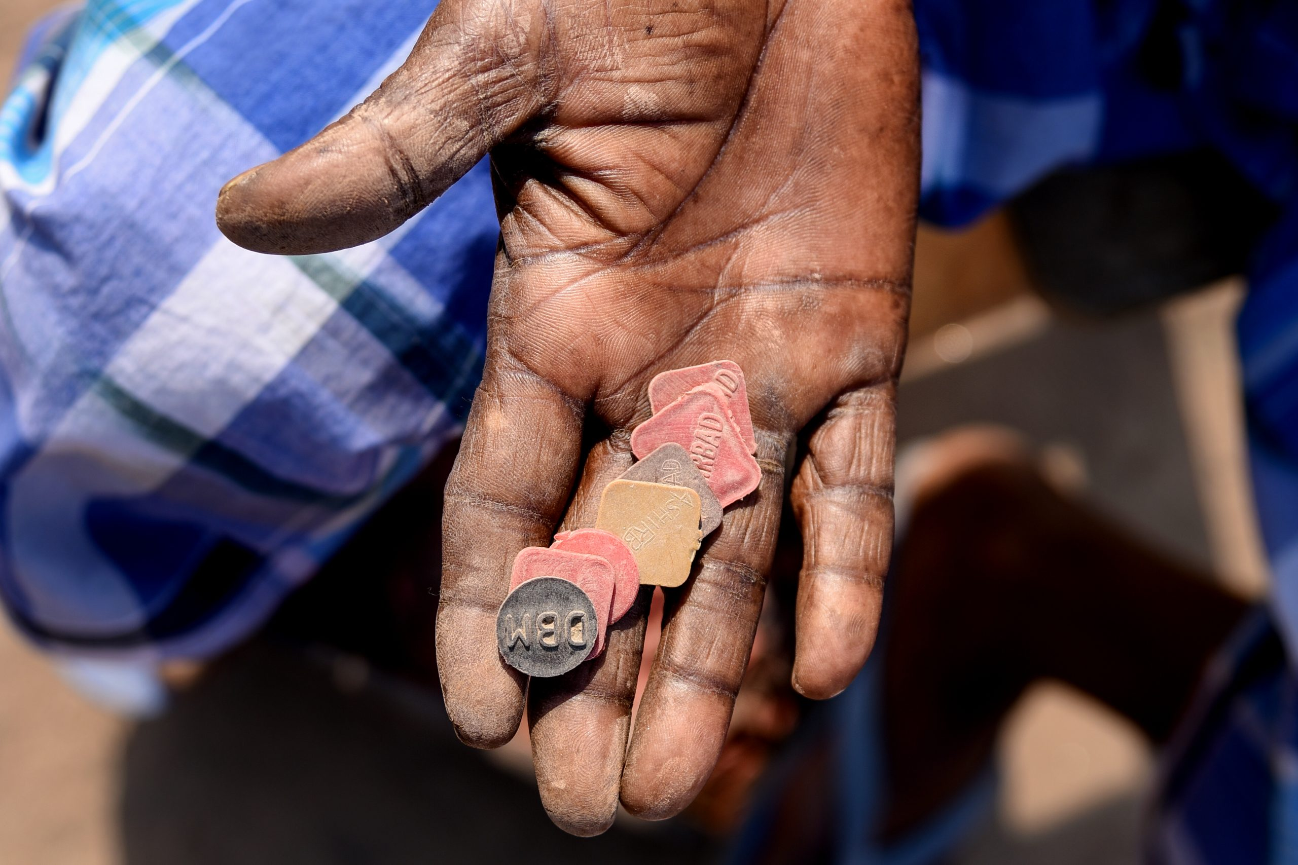 Man's hands with some tokens
