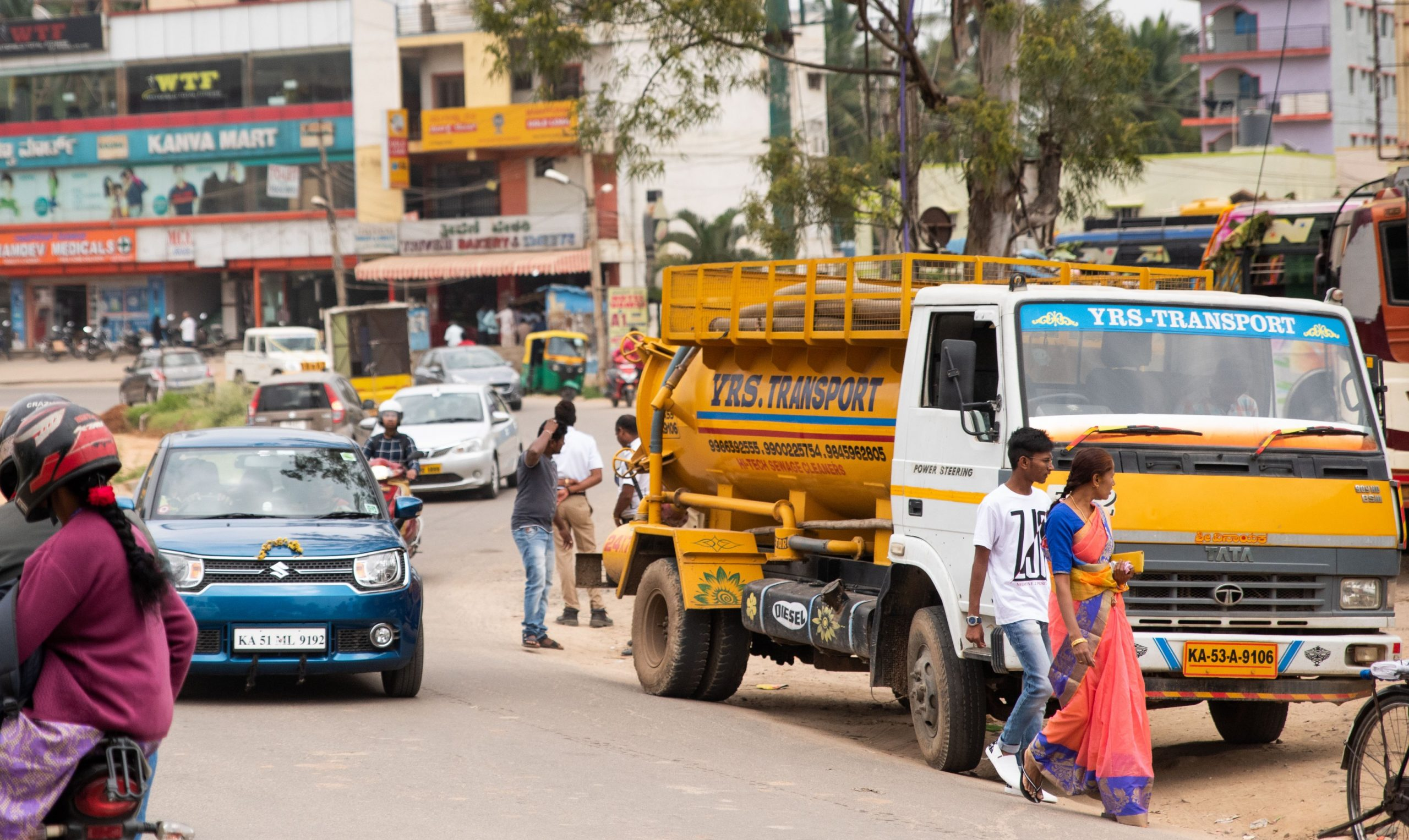 Faecal sludge truck in the city_sanitation workers_epw