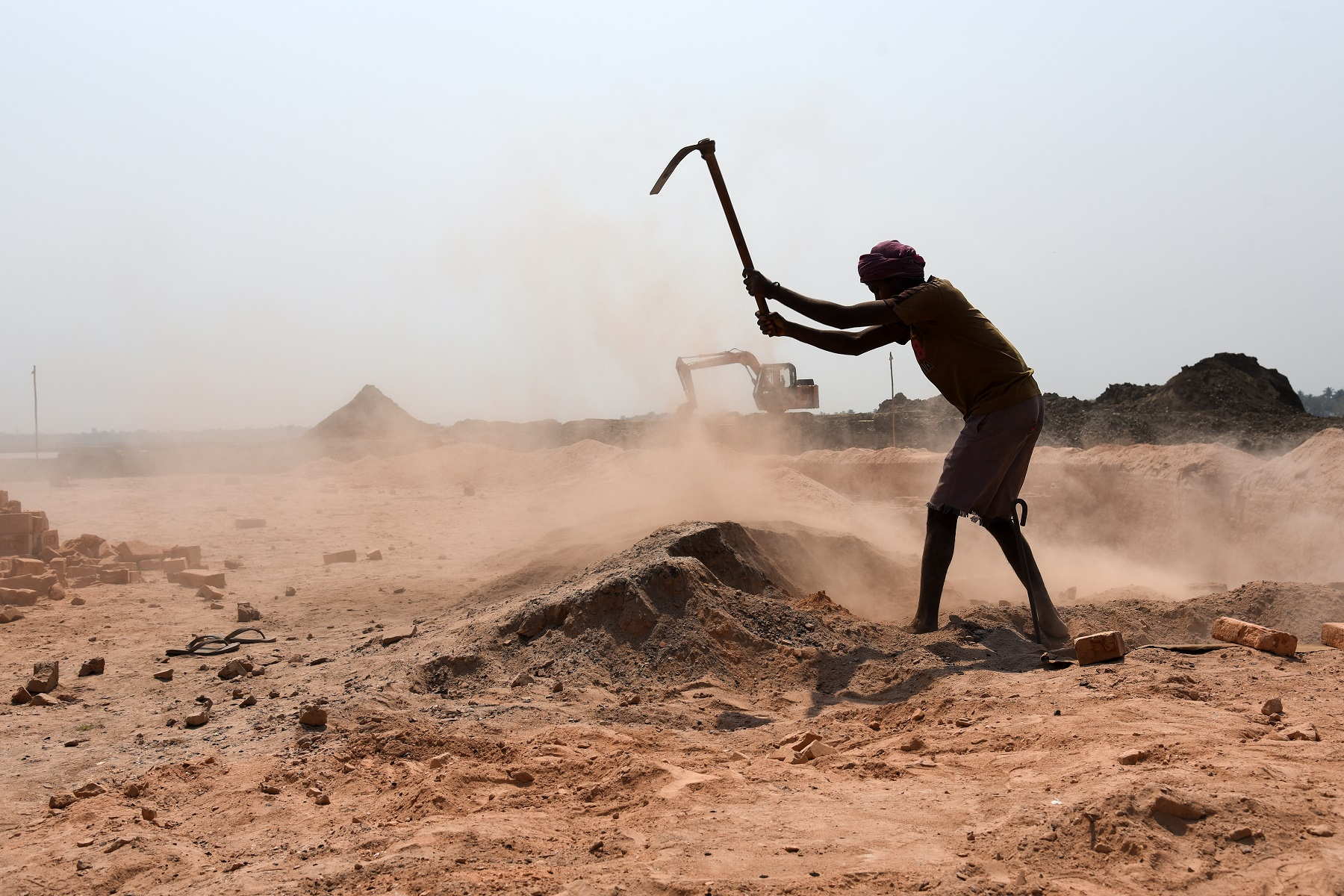 An Indian man labourer at a brick kiln