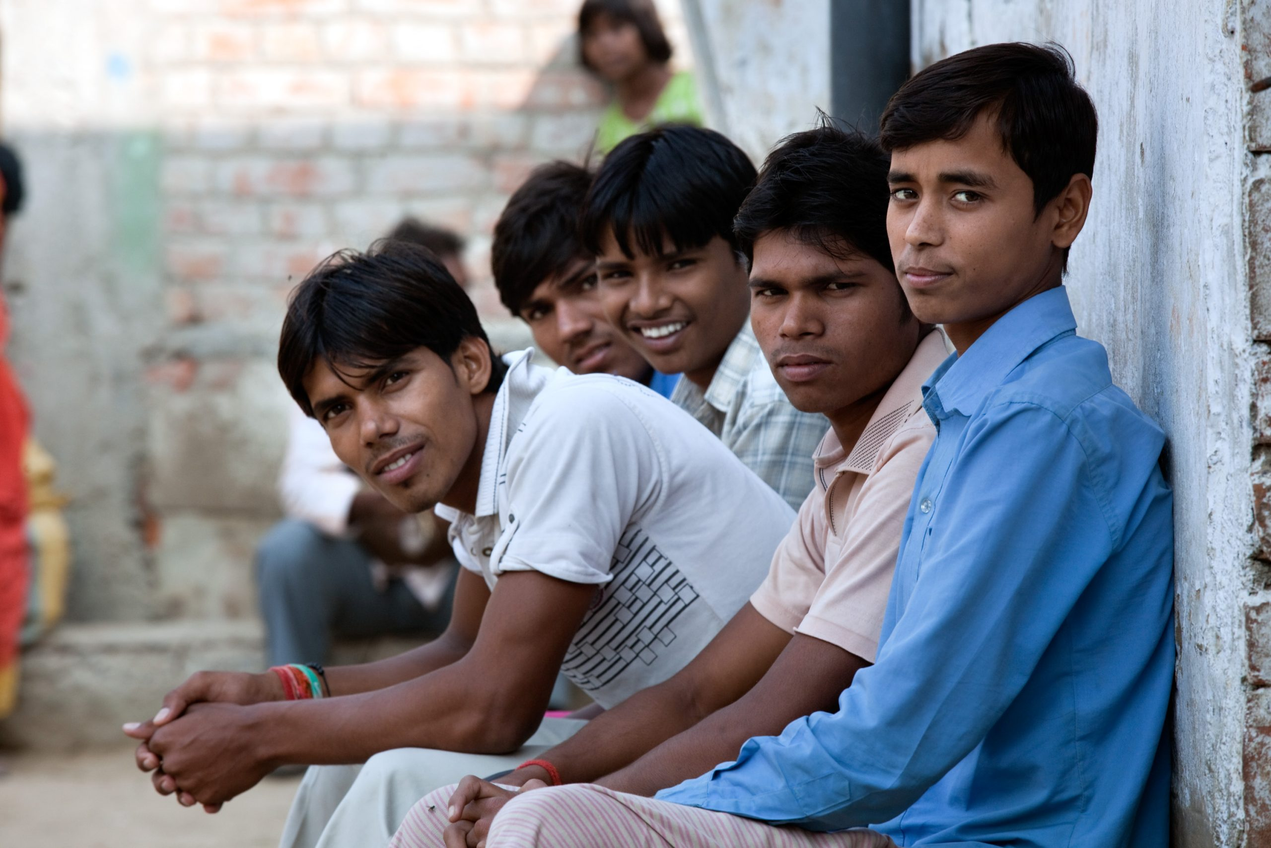 A group of adolescent boys in India sitting together