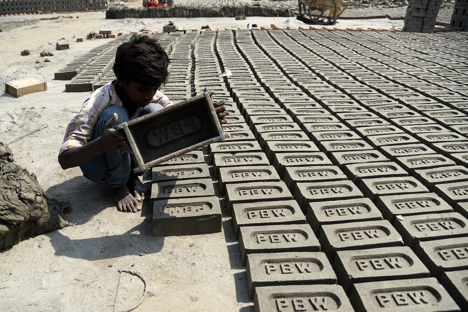 Pawan Kumar a young Indian boy moulds up to 200-300 bricks a day