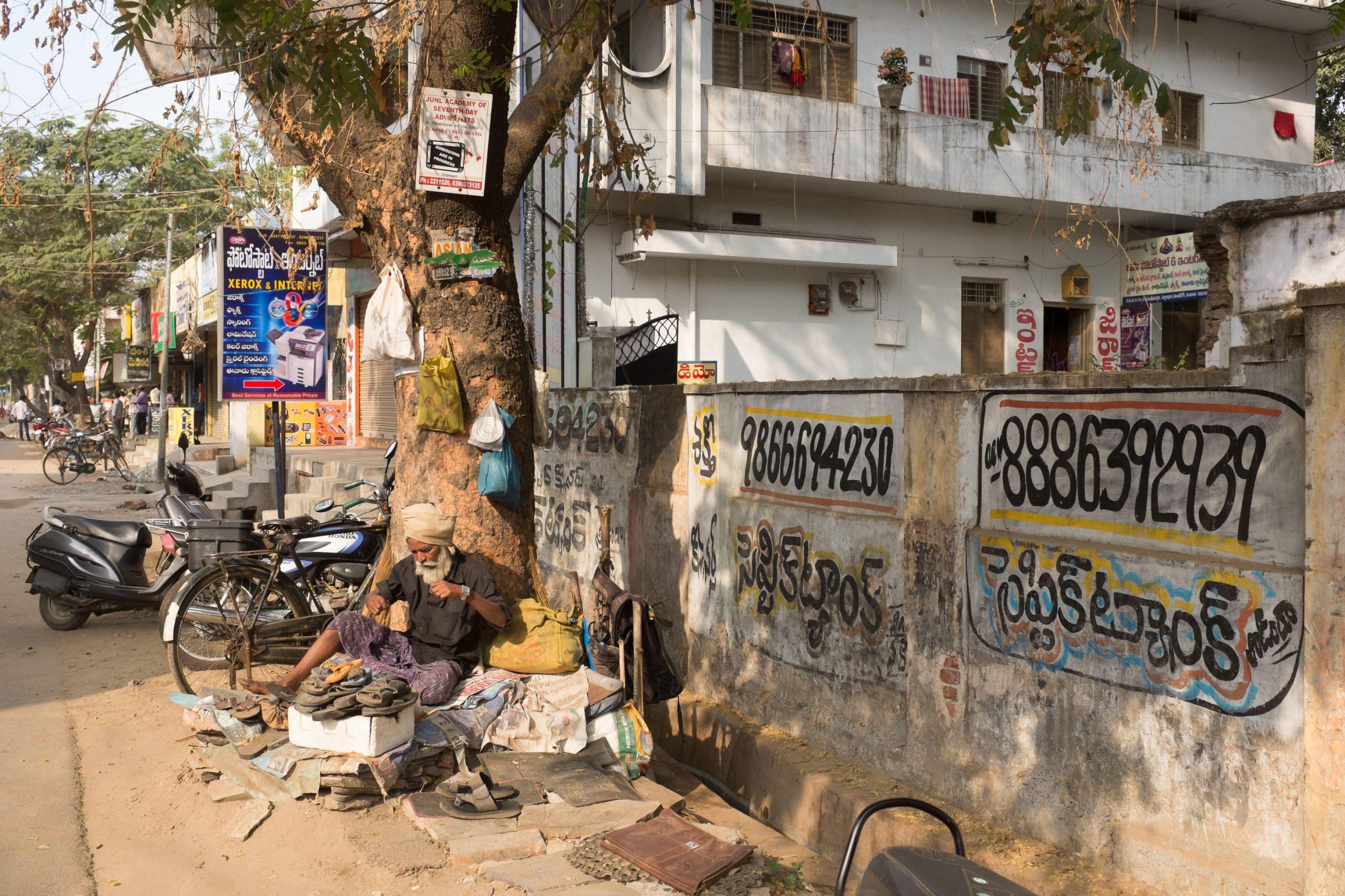 cobbler on the roadside_sanitation workers_epw