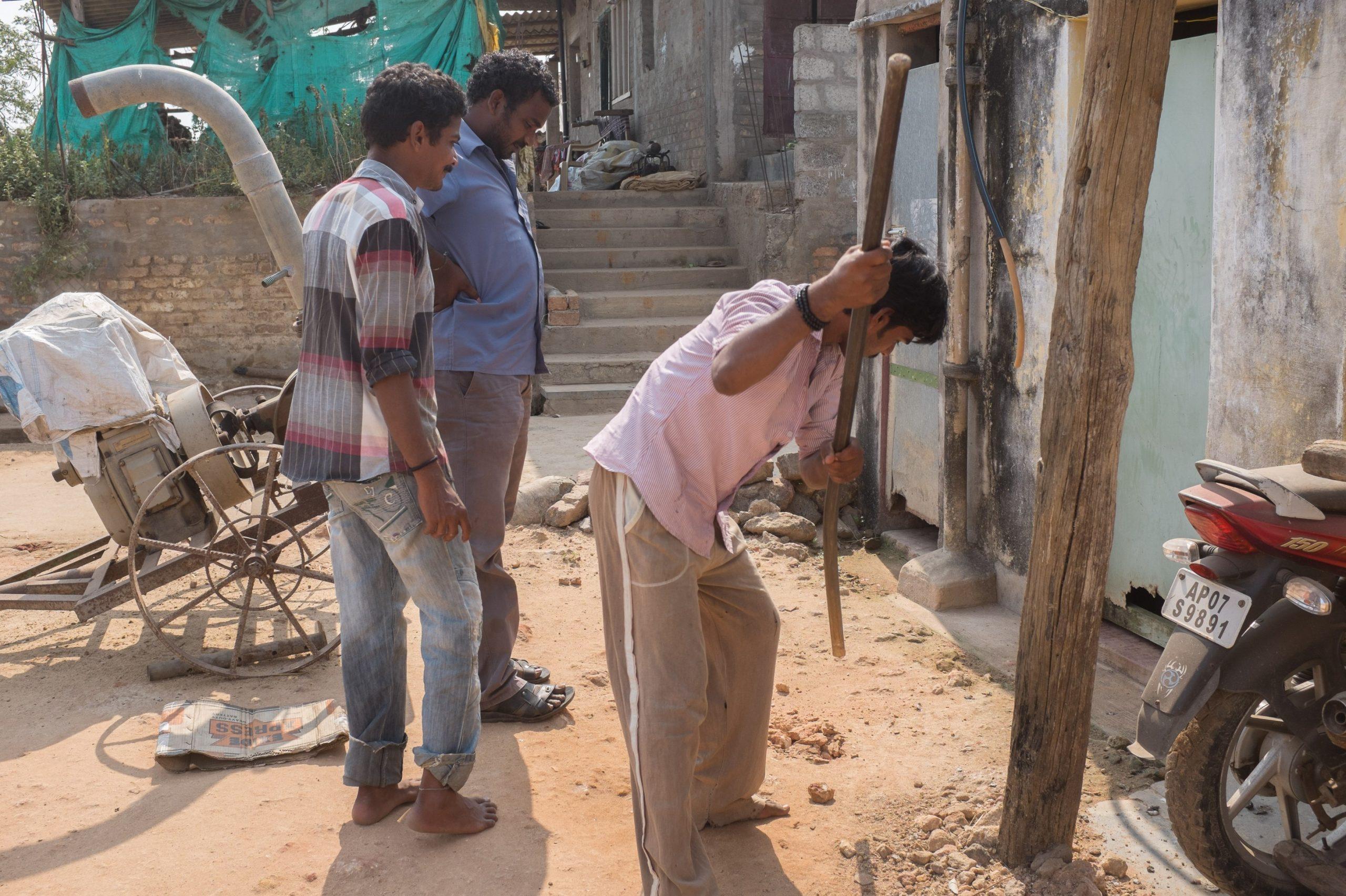 Men digging a sewage pit_sanitation workers_epw