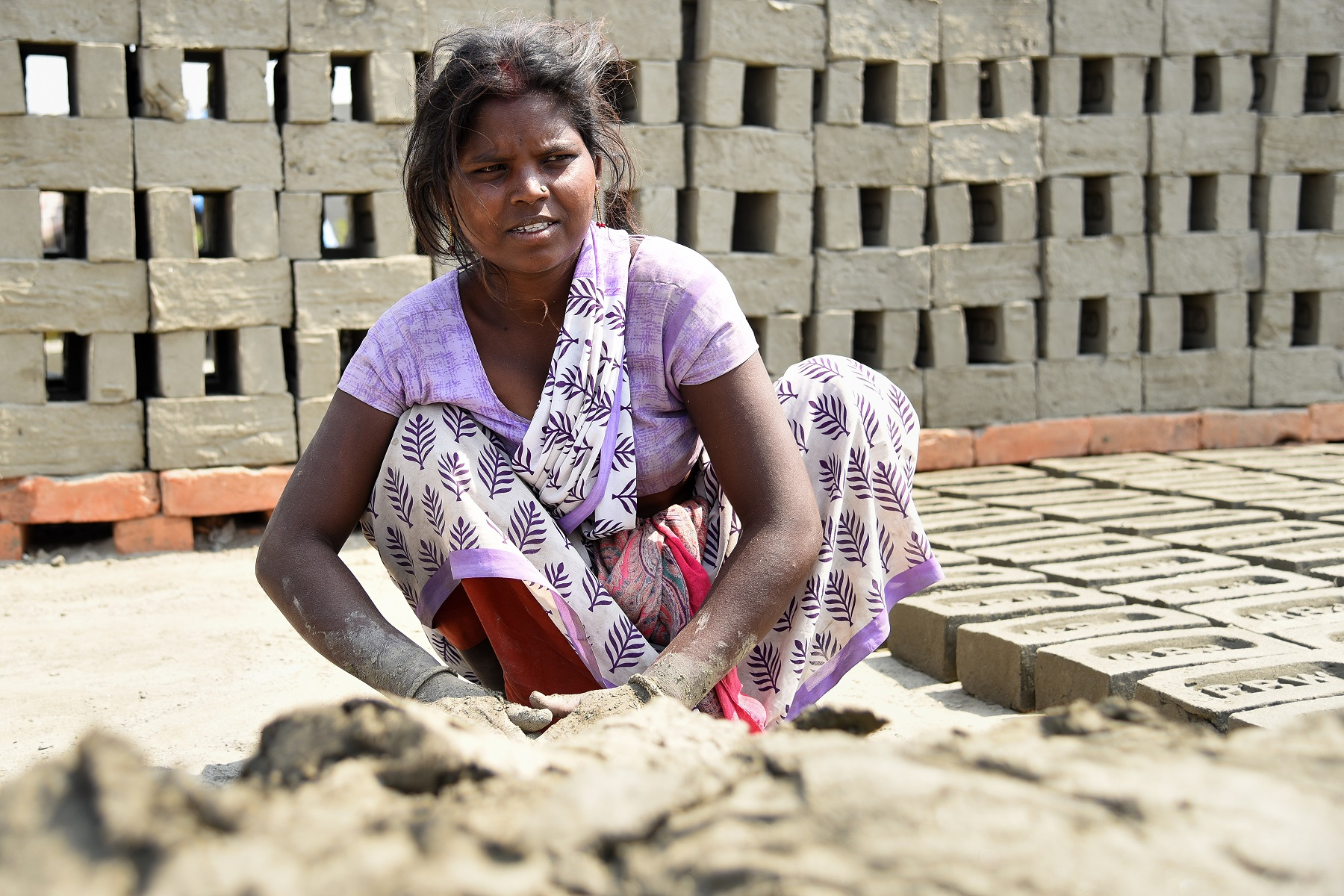 An adolescent Indian girl at a brick kiln
