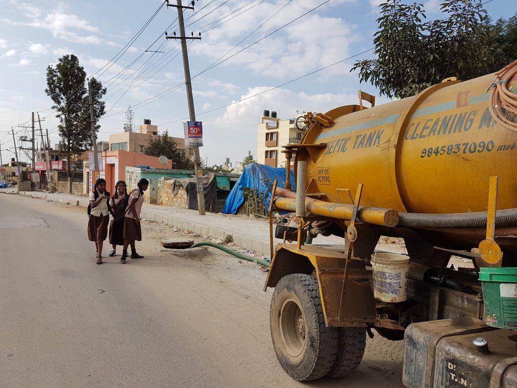 Dumping faecal sludge in drains_sanitation workers_epw