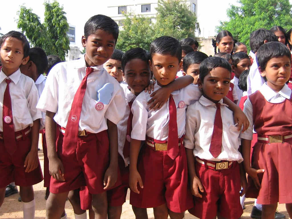 A group of young Indian boys in school uniform