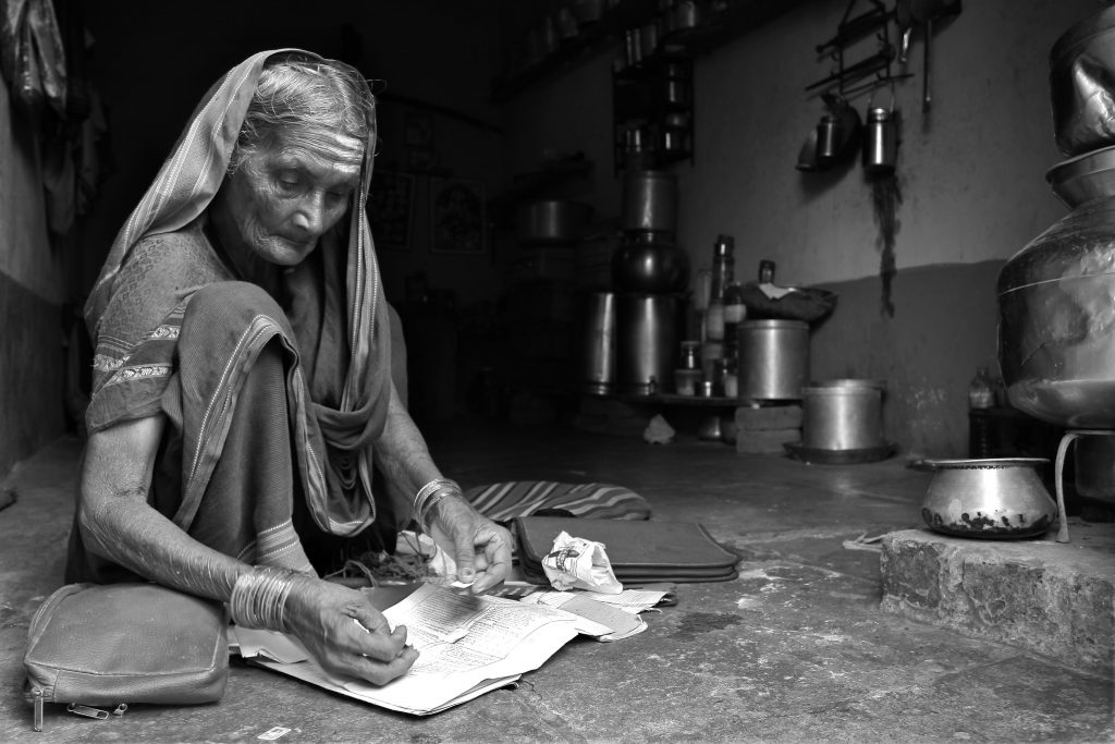 ASwaminathan old Indian woman writing on paper-ageing in india