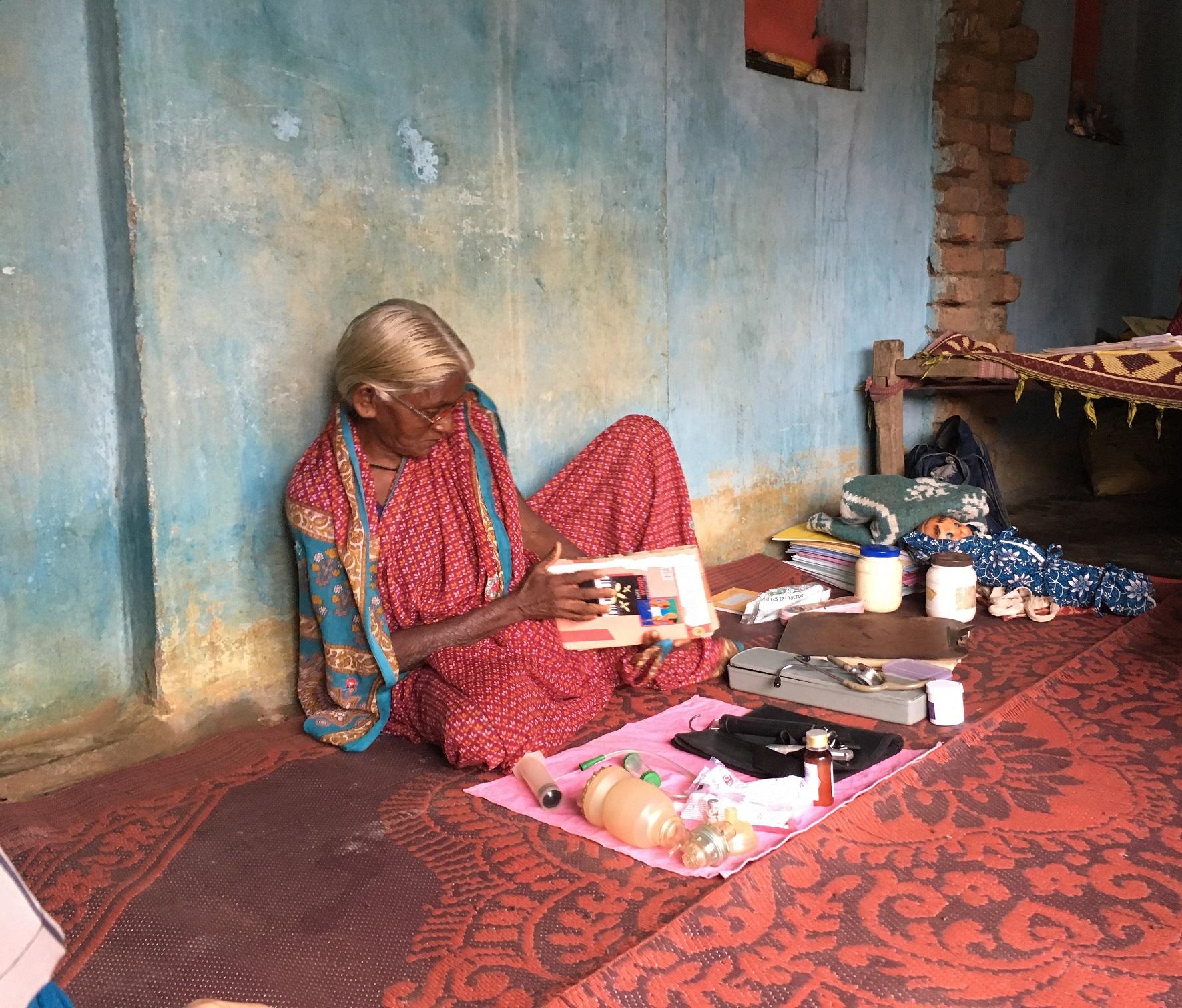 An Adivasi woman with a medical kit