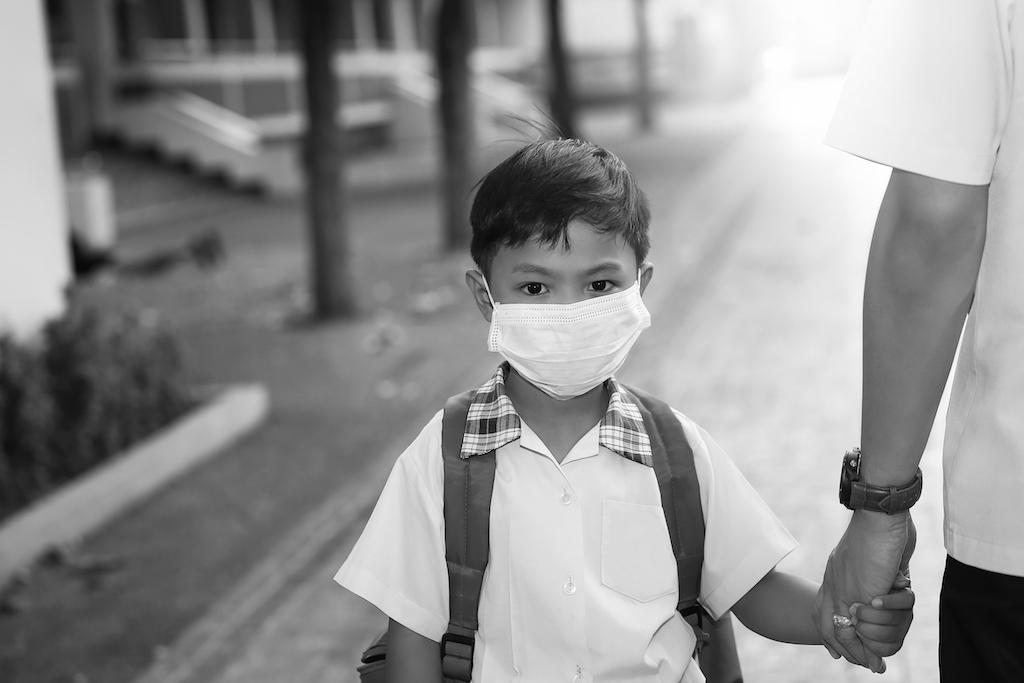 Boy in school uniform wearing face mask