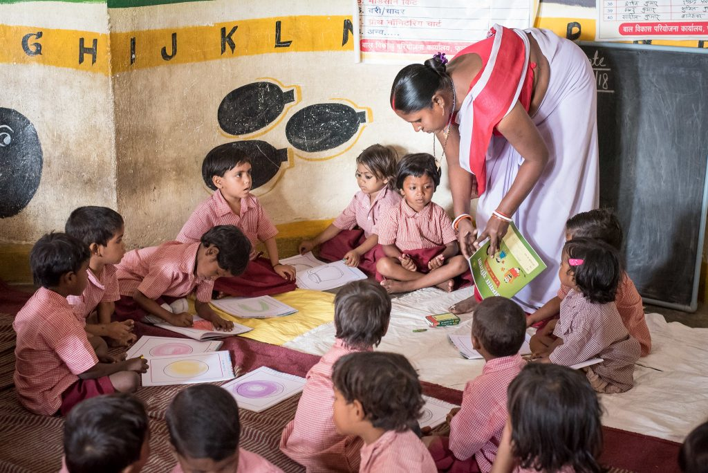 Children colouring in an anganwadi in Patna, India