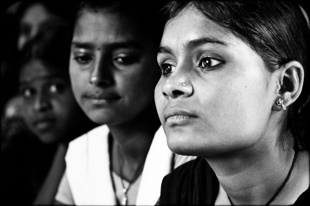 Close up of two Indian women's faces -women and development