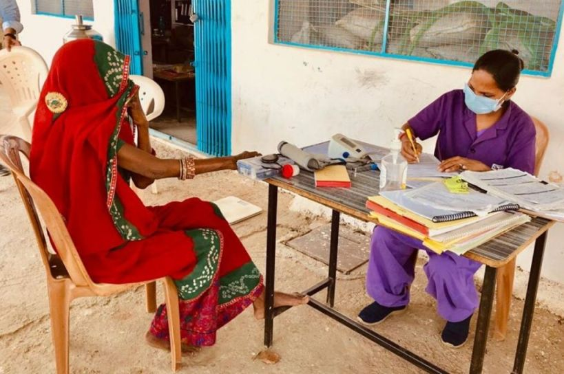 woman getting primary healthcare-covid