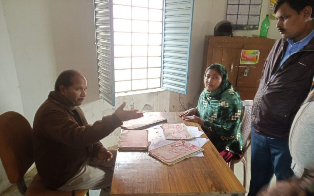 two people sitting in an office and talking-panchayat member