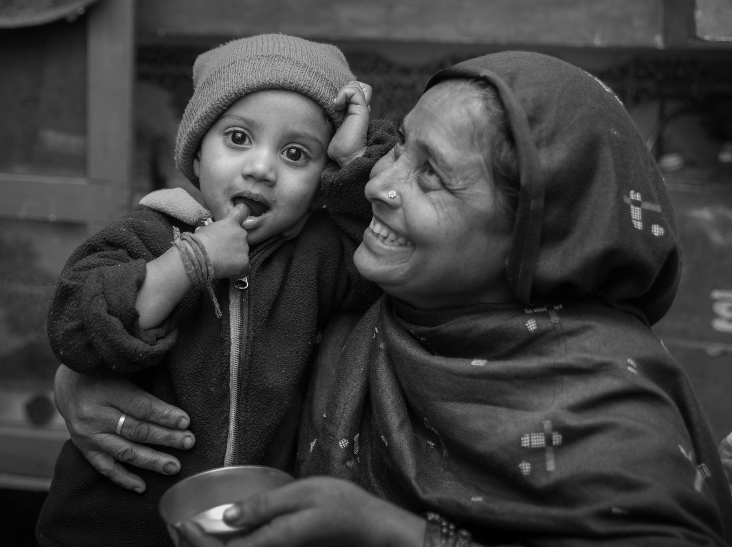 mother smiling and holding child