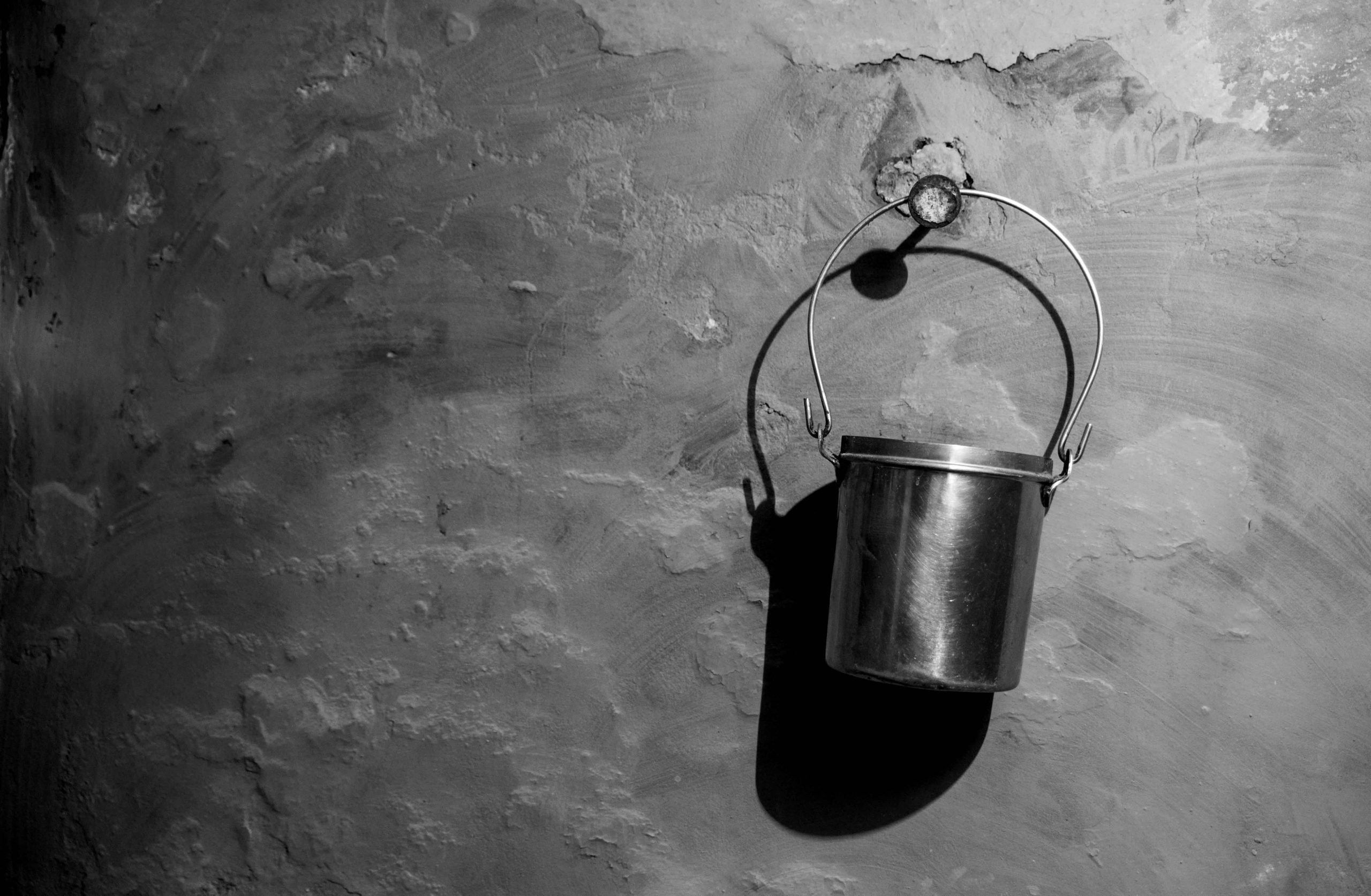 small bucket hanging on wall
