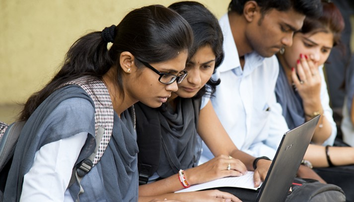 Indian students using laptop