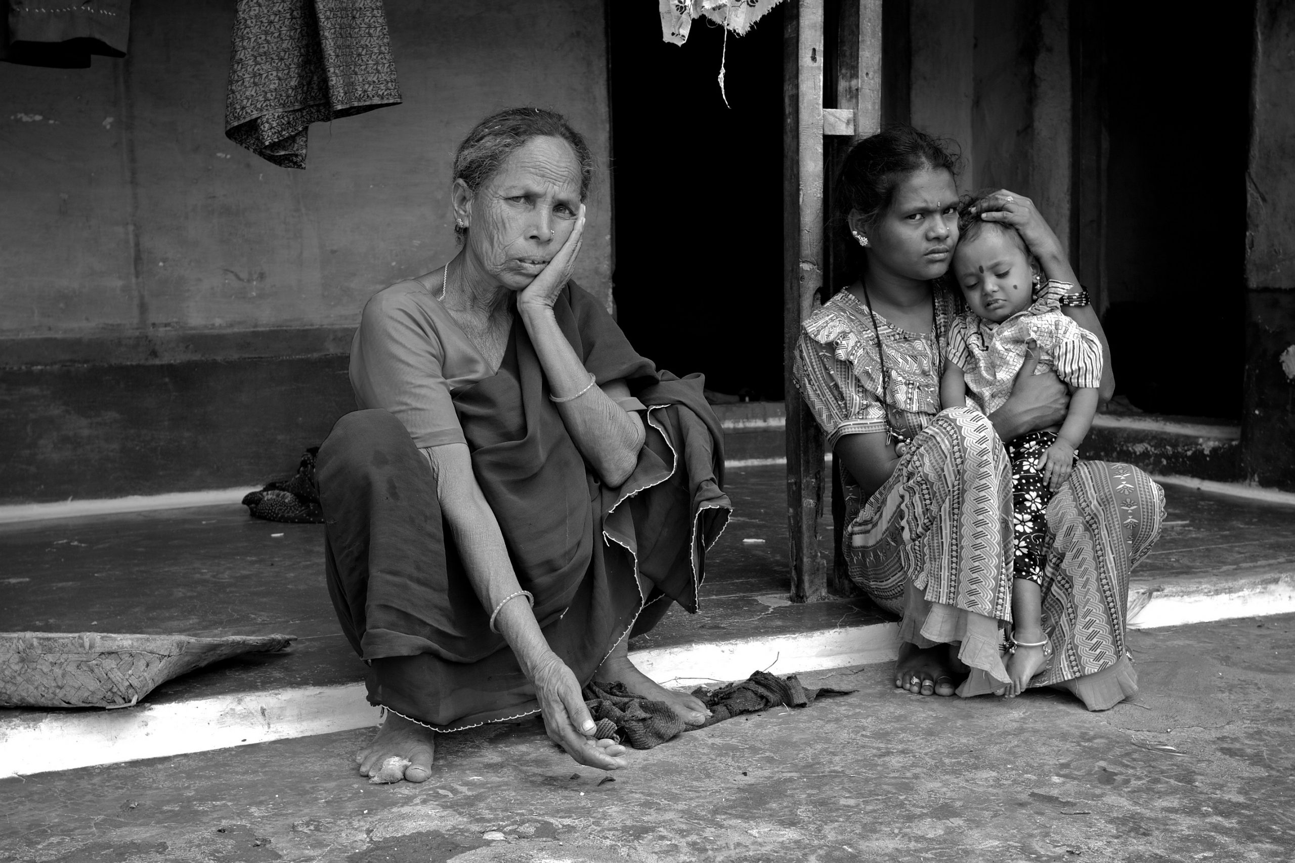 Indian women sitting outside their house-women and development