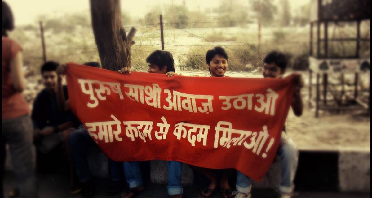 group of men with banner_Jagori