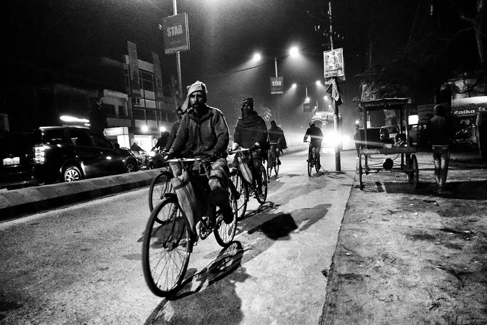 workers on cycles at kathiar junction railway station-migrant workers