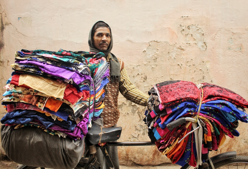 Man selling fabric on cycle