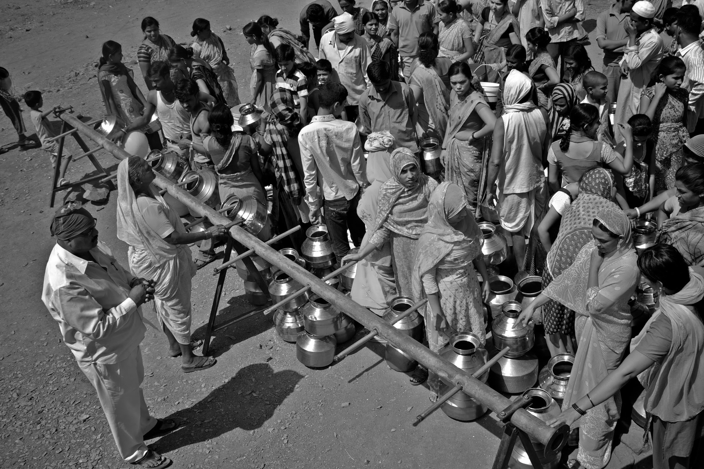 People waiting in line for water_ASwaminathan