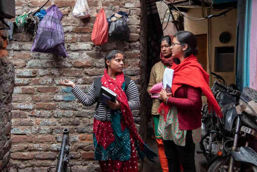 Agents from Haqdarshak, an Acumen investment in Delhi, work in the community to connect eligible citizens to welfare schemes
