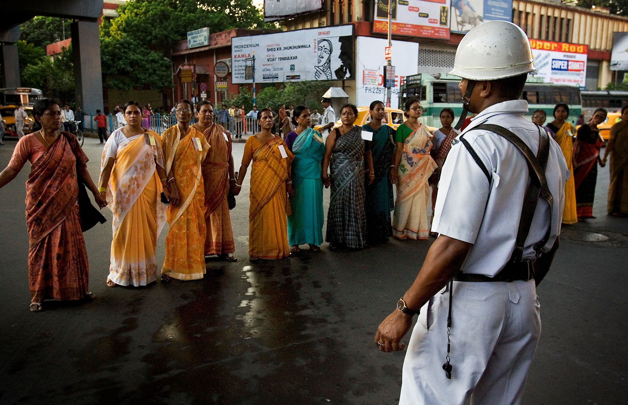 Policeman facing women in a protest march, Calcutta_gender based violence
