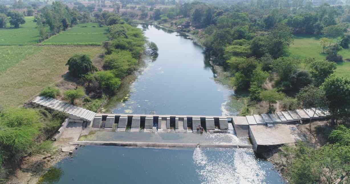 image of a checkdam across a river in Dahod, Gujarat-rural livelihoods