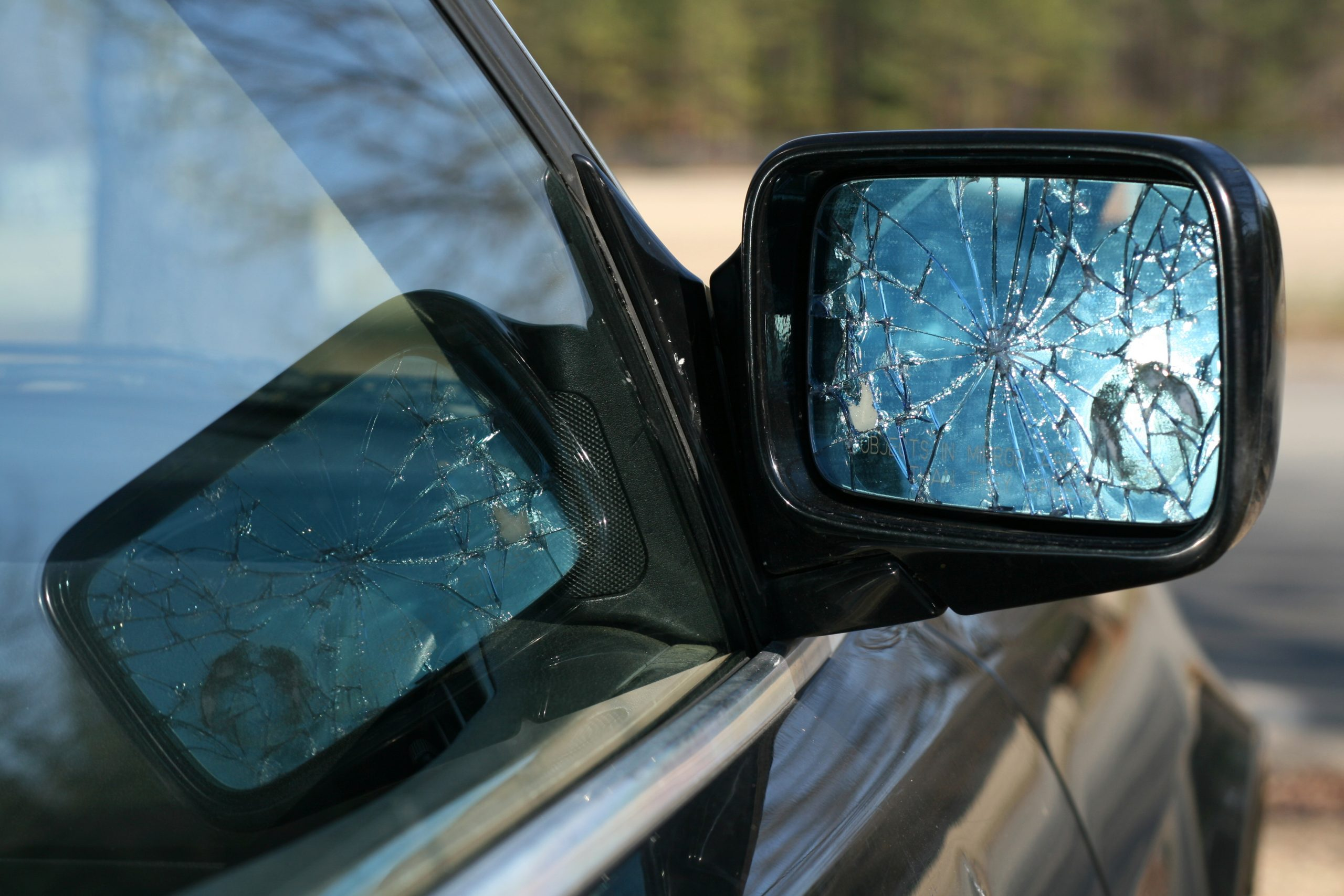 Shattered rear view mirror of car-rich list