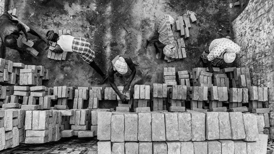 aerial black and white shot of brick kiln workers_flickr