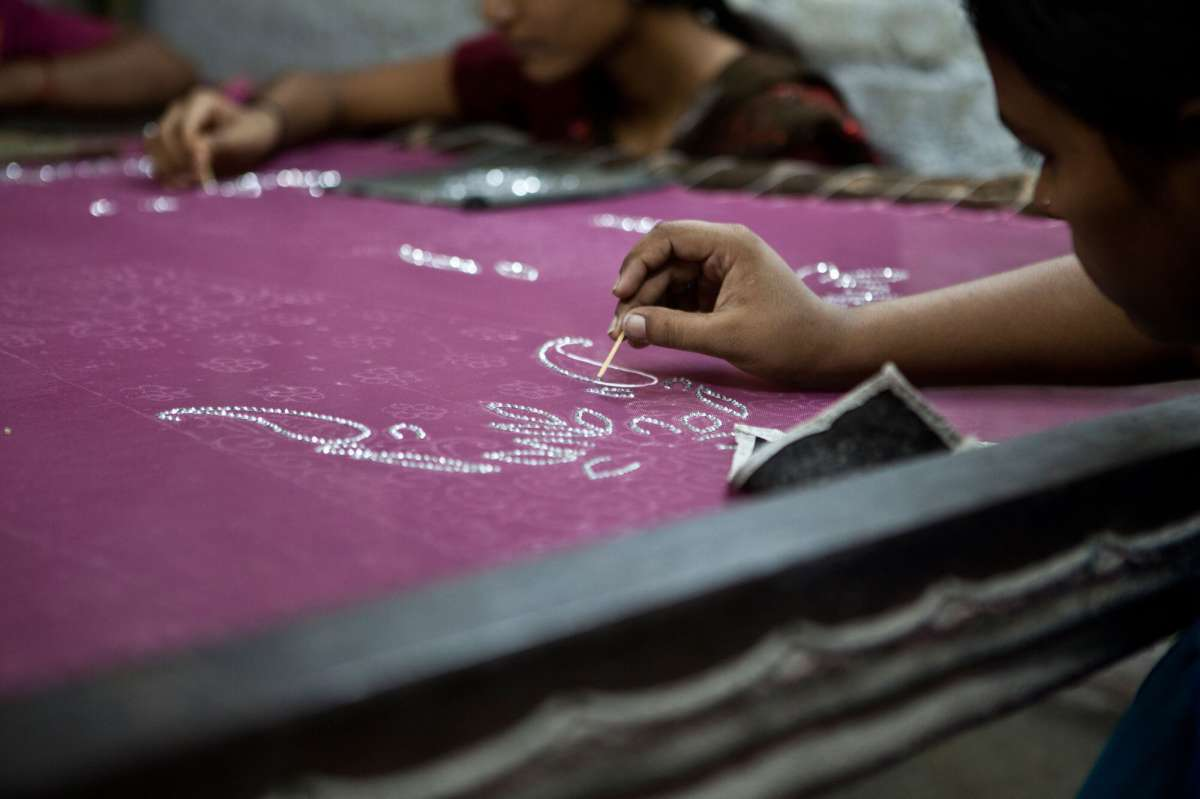 close up of a girl working on a piece of cloth-women entrepreneurship