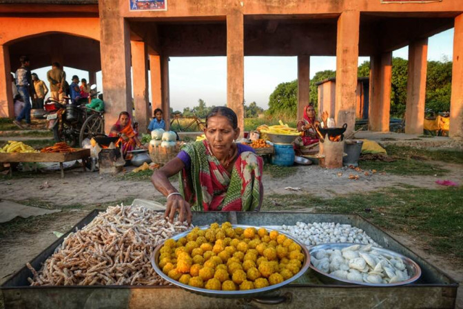 Woman vendor selling food in a market