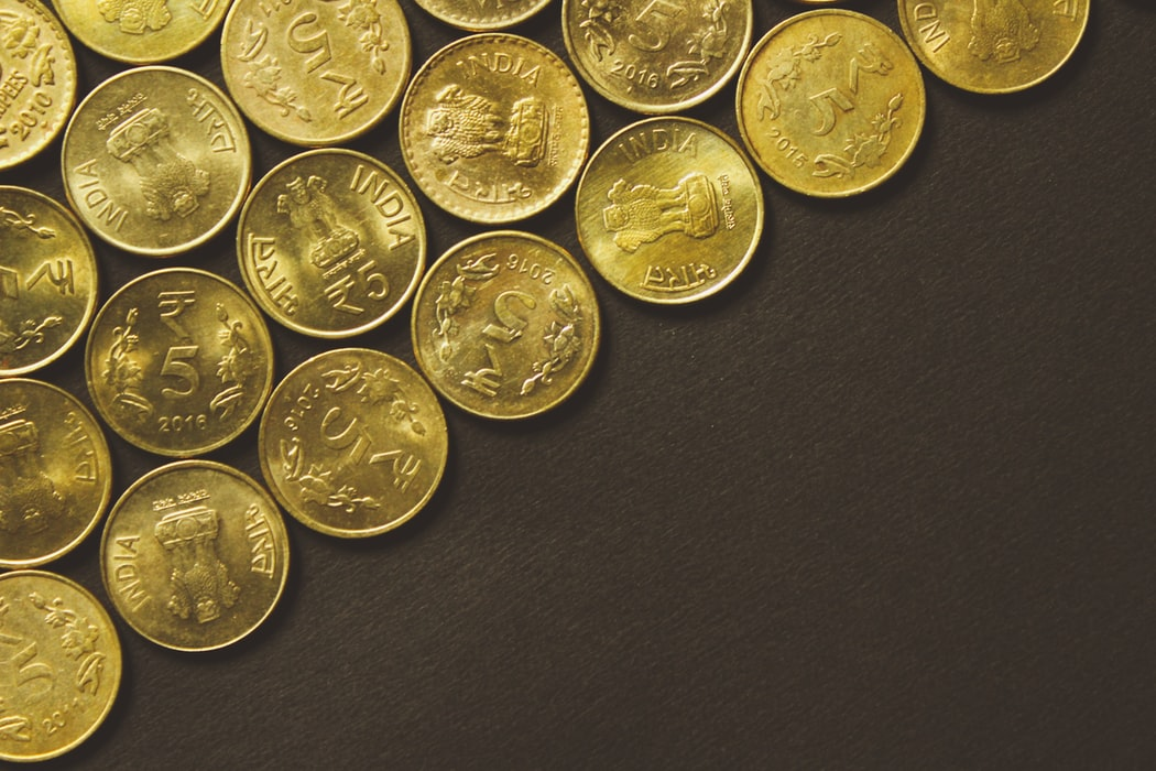INR denomination five coins arranged in a diagonal_Unsplash
