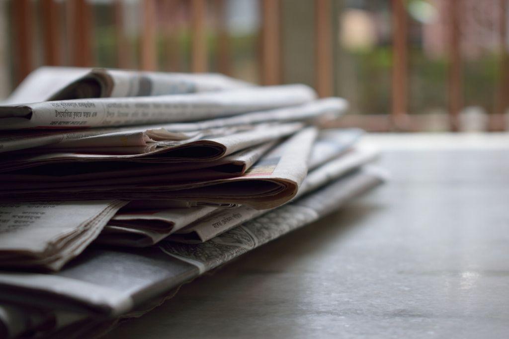 stack of newspapers_covid_lockdown_pexels