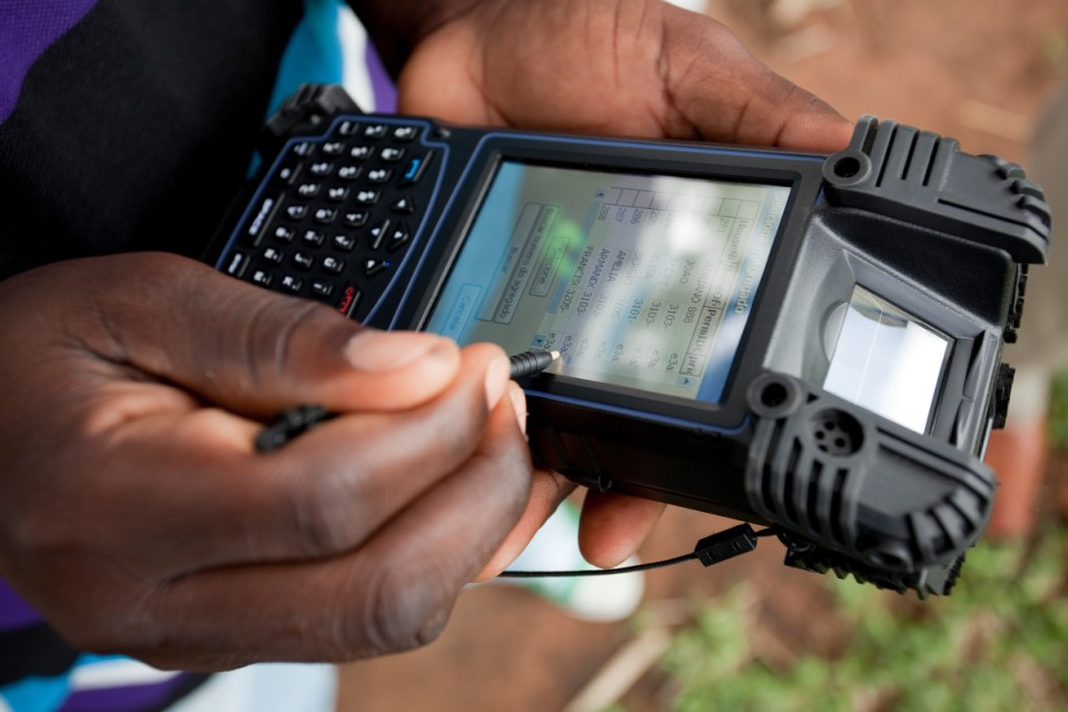 Surveyer using electronic device to gather data