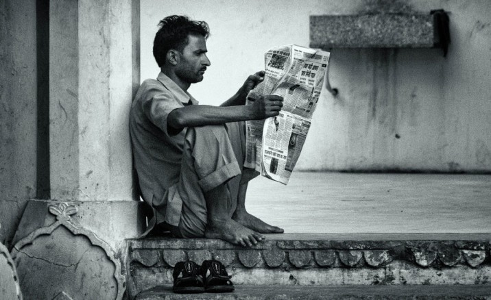 Person reading a newspaper-crimes against women