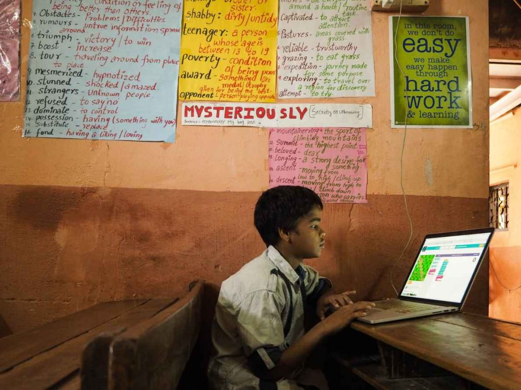 Student sitting in a classroom with a laptop-EdTech Policy