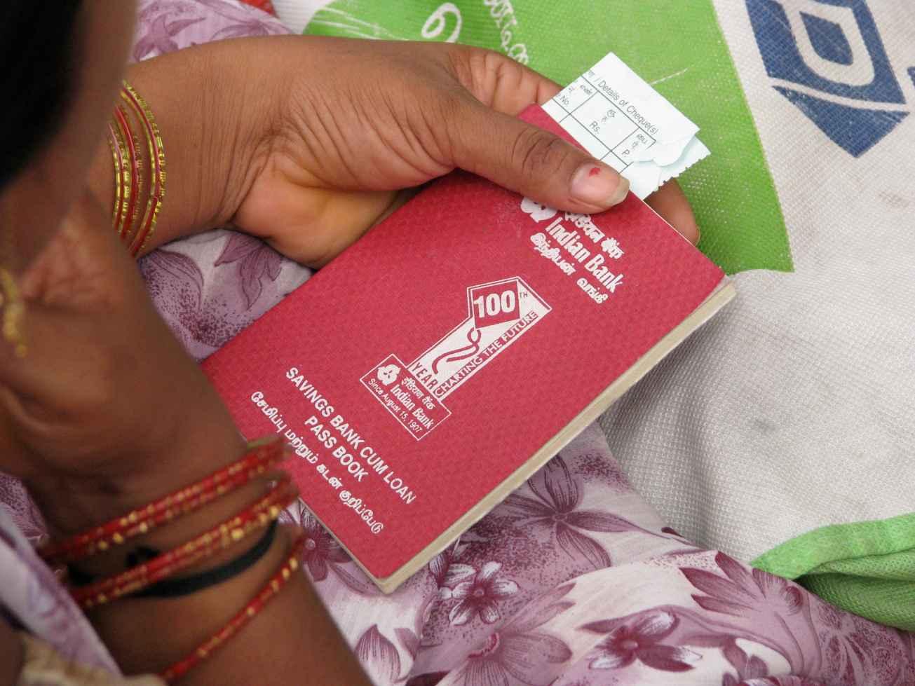 Woman holding a passbook-women's empowerment