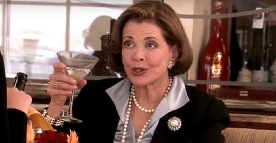 Lucille Bluth holding up a glass-Lucille Bluth