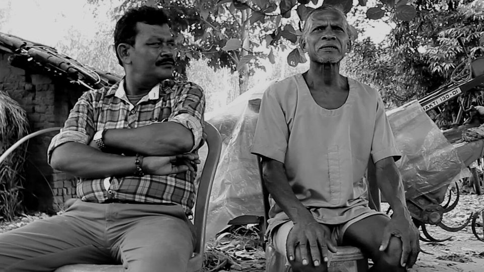 black and white image of the gram pradhan talking about the Bhoodan movement
