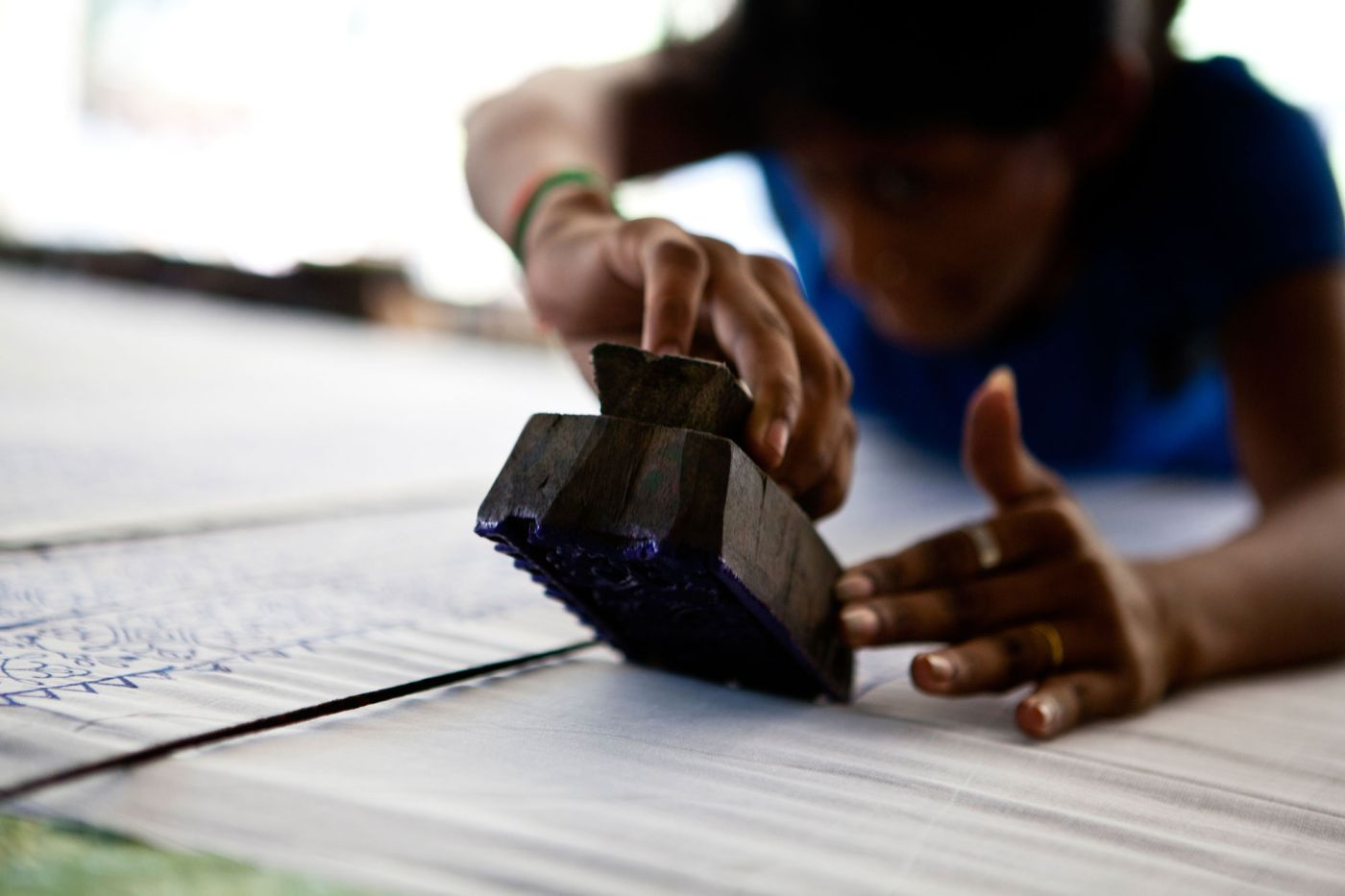 close up of a person block printing-vocational training