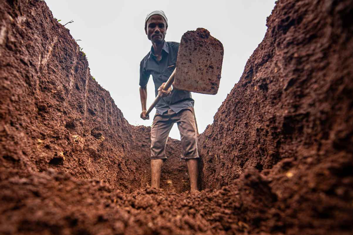 man digging a pit-rural employment