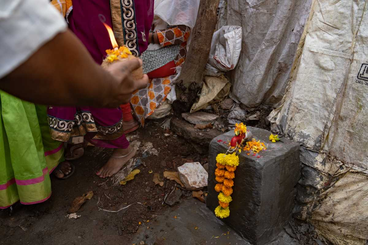 A tap on a cement block, garlanded and being worshipped-access to water