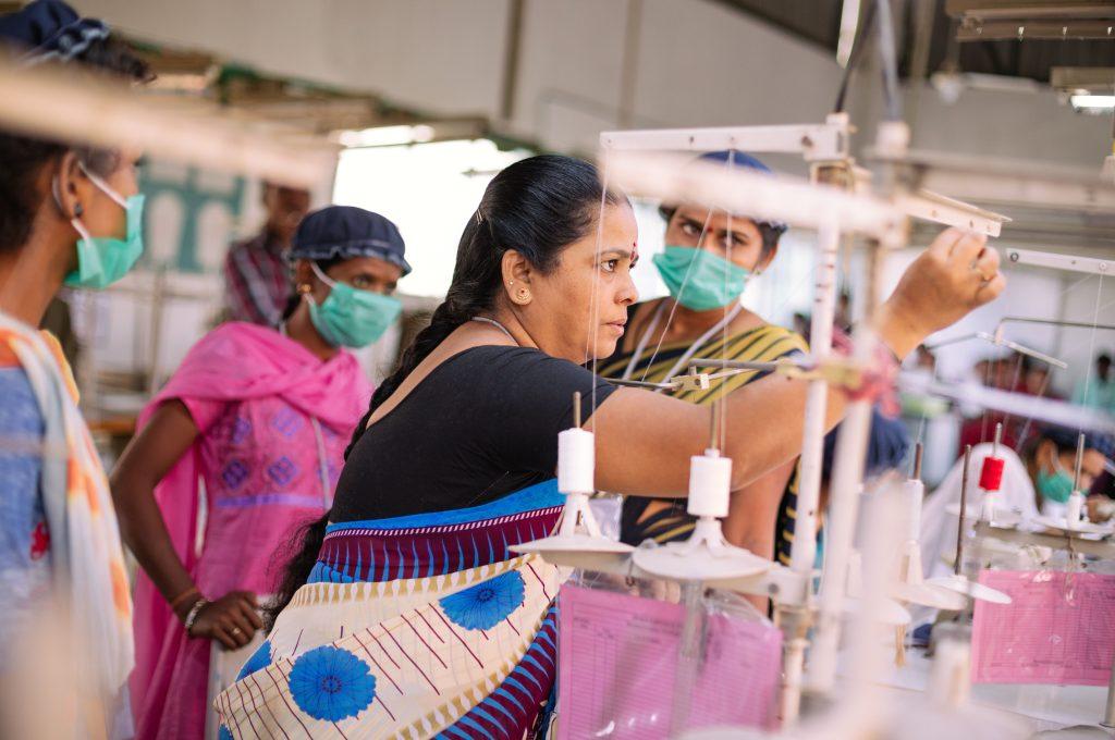 Female supervisor demonstrating scut work-garment factories
