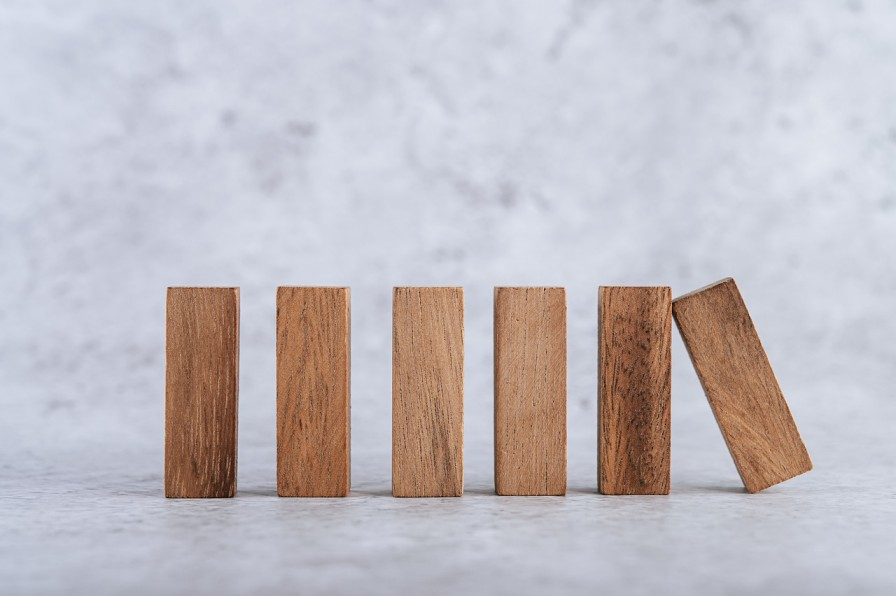 Wooden blocks lined up next to each other-impact investing
