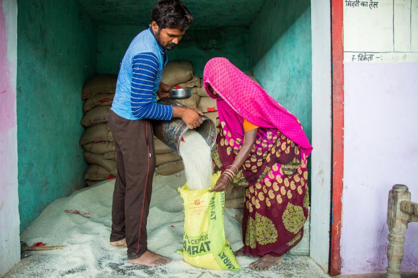 man giving a woman ration-social welfare schemes